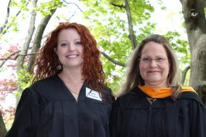 Lori Kenyon and Lisa Mihlbauer, of the UW-Milwaukee nursing faculty, celebrate Lori's graduation from the competency-based education RN to BSN program.